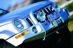 ARB 4x4 Accessories - ARB 3438050 Front Deluxe Bull Bar Winch Bumper Nissan Pickup 1995-1997